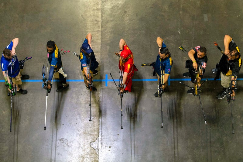 Archers draw bows during the final round of archery at the 2019 Department of Defense Warrior Games in Tampa, Fla., June 25, 2019.
