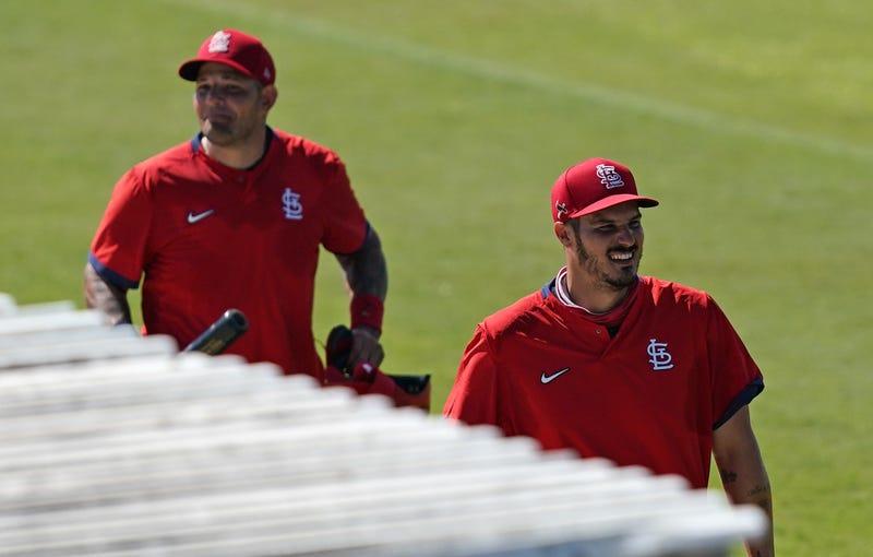 Yadier Molina and Nolan Arenado arrive at Cardinals spring training.