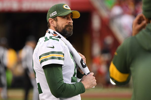 Aaron Rodgers looks on from the Packers sideline.