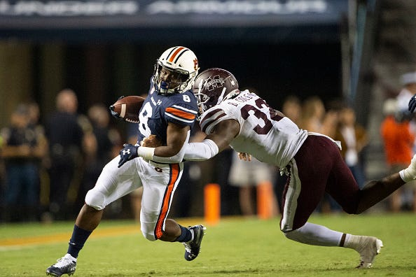 Auburn's Shaun Shivers rushes the ball against Mississippi State.
