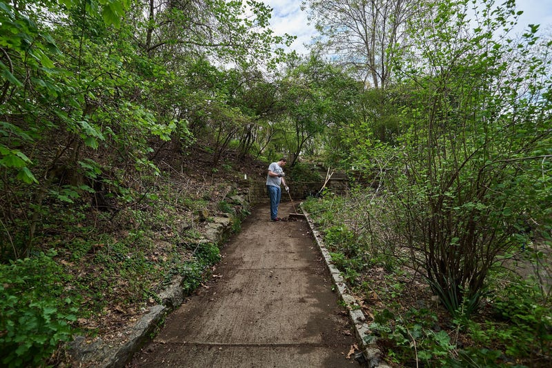 A volunteer takes part in the Fairmount Park Conservancy's Love Your Park Solo campaign.