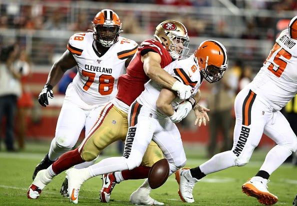 49ers DE Nick Bosa strip sacks Browns QB Baker Mayfield.