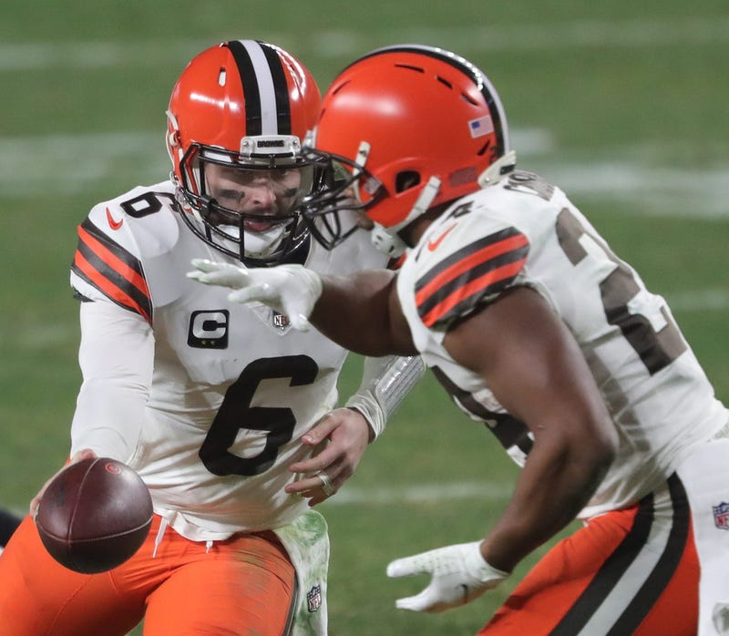 Cleveland Browns quarterback Baker Mayfield hands the ball off to Cleveland Browns running back Nick Chubb during the second half of an NFL wild-card playoff football game, Sunday, Jan. 10, 2021, in Pittsburgh, Pennsylvania.