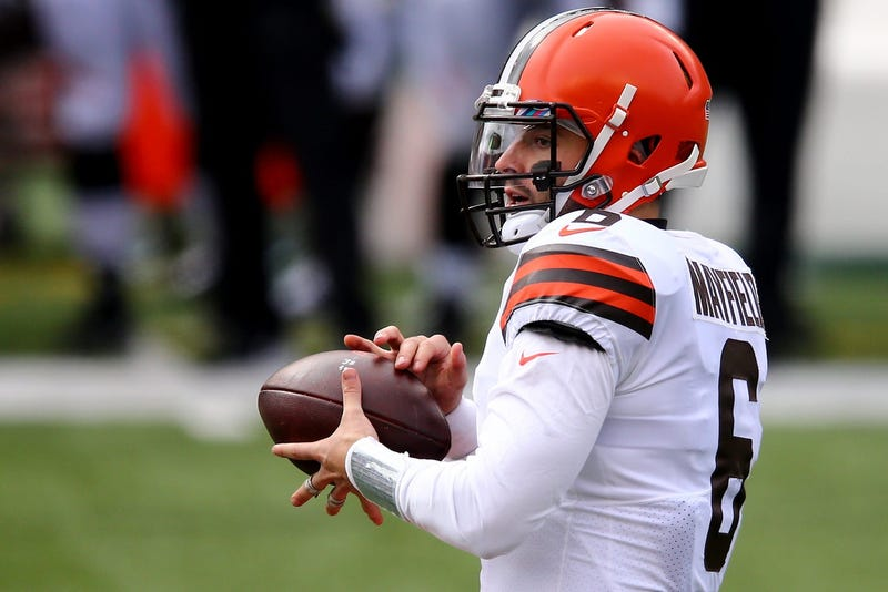 Cleveland Browns quarterback Baker Mayfield takes the snap and looks to pass during the first quarter of a Week 7 NFL football game against the Cincinnati Bengals, Sunday, Oct. 25, 2020, at Paul Brown Stadium in Cincinnati.