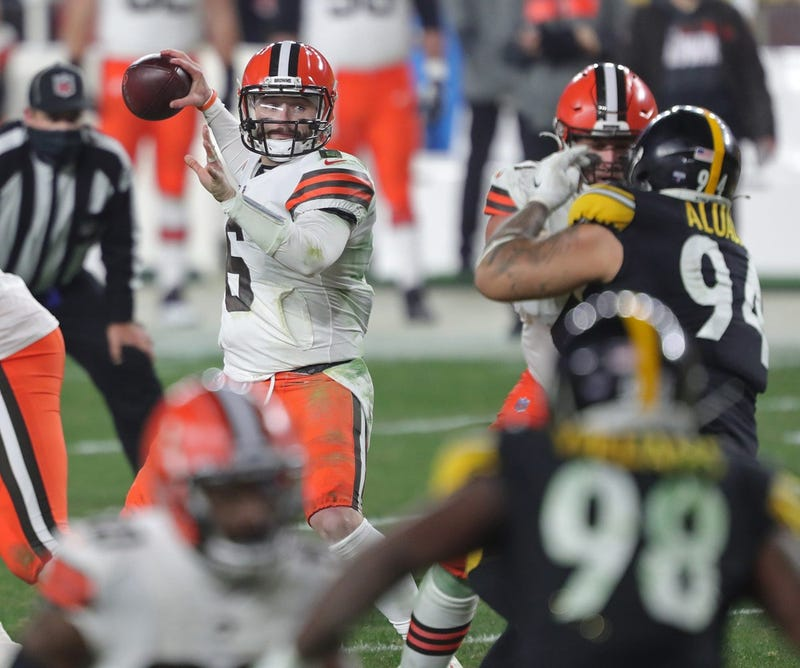 Cleveland Browns quarterback Baker Mayfield looks to make a pass during the second half of an NFL wild-card playoff football game, Sunday, Jan. 10, 2021, in Pittsburgh, Pennsylvania.