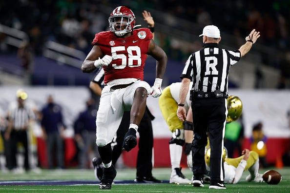 Christian Barmore celebrates a sack against Notre Dame.