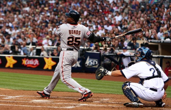 Barry Bonds crushes a ball during a Giants game.