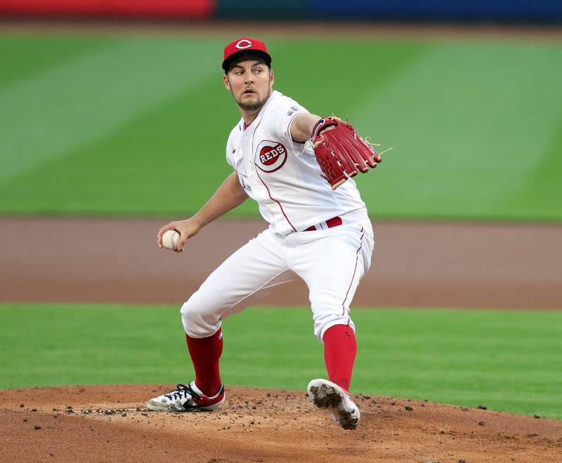 Trevor Bauer pitches in a game for the Reds