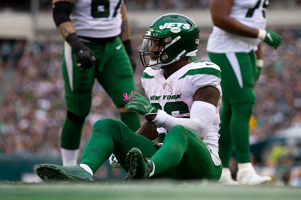 Jets RB Le'Veon Bell sits on the ground during a game against the Eagles.