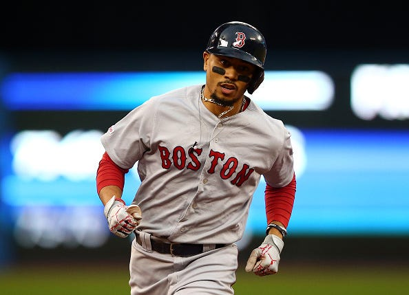 Mookie Betts rounds the bases after hitting a home run.