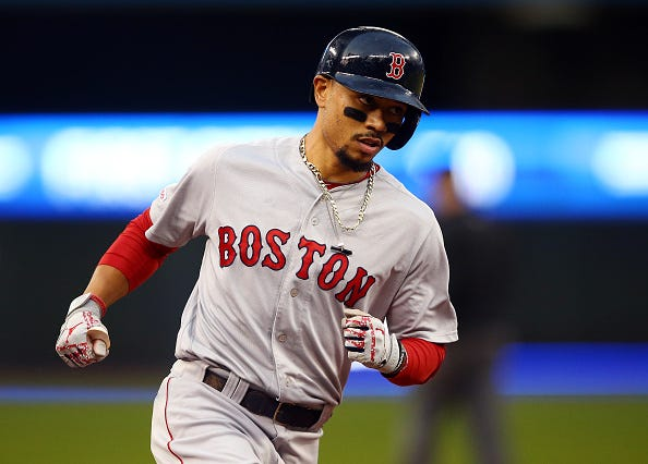 Red Sox Mookie Betts rounds the bases after homering against the Blue Jays.