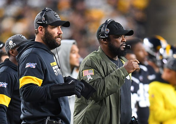 Ben Roethlisberger and Mike Tomlin watch from the Steelers sideline.