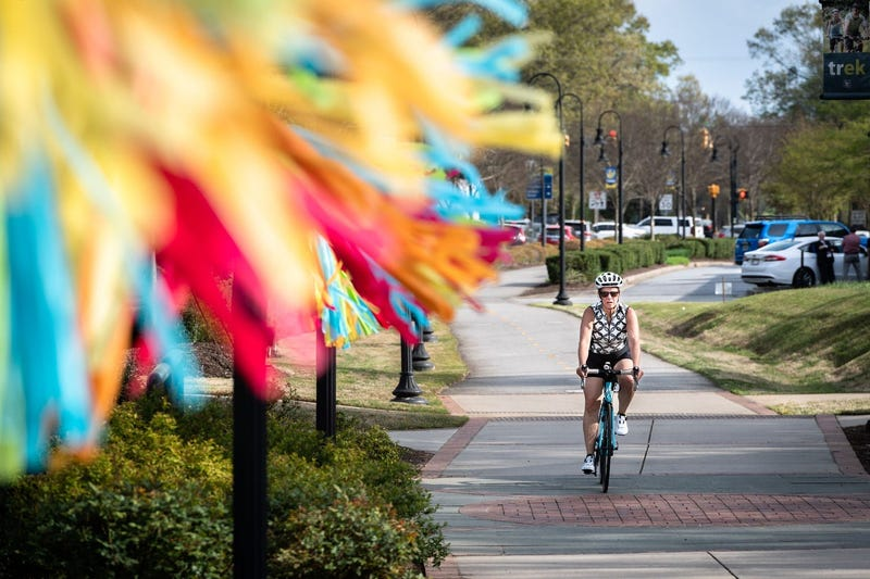 Woman Bikes in Travelers Rest