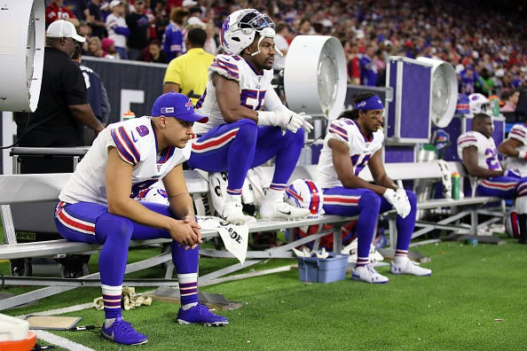 Bills players watch in disappointment as they fall to the Texans.