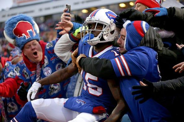 John Brown celebrates a TD with Bills fans.