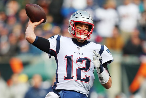 Tom Brady throws a pass against the Bengals.