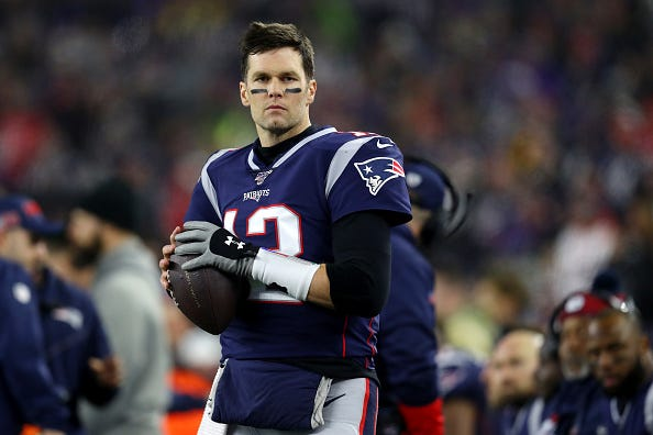 Tom Brady warms up before a playoff game for the Patriots