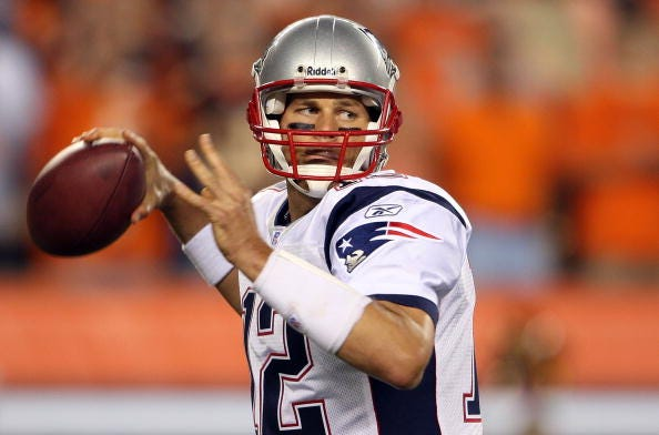 Tom Brady looks for a receiver down field in a 2007 game with the Patriots.