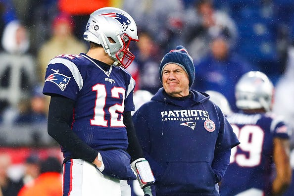 Tom Brady and Bill Belichick share a moment on the sideline.