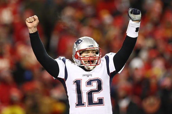 Tom Brady celebrates a TD against the Chiefs in the 2019 AFC Championship.
