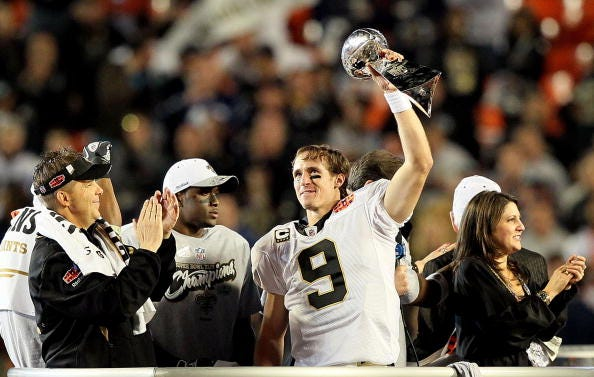 Drew Brees celebrates winning a Super Bowl with the Saints.