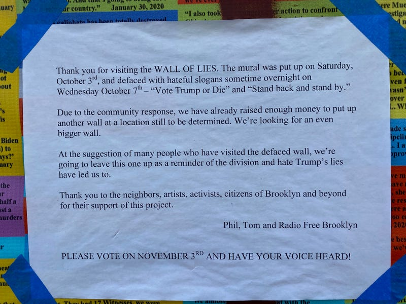 A sign at the Wall of Lies in Bushwick, an installation with 20,000 lies told by President Trump