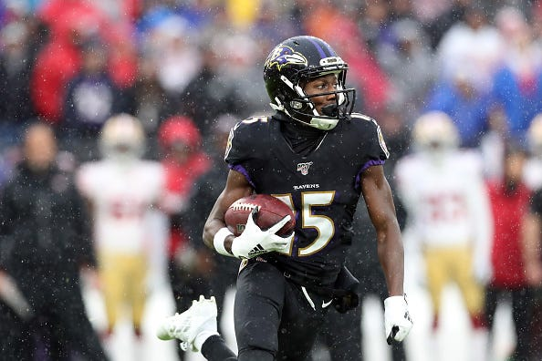 Marquise Brown of the Ravens runs after making a catch.
