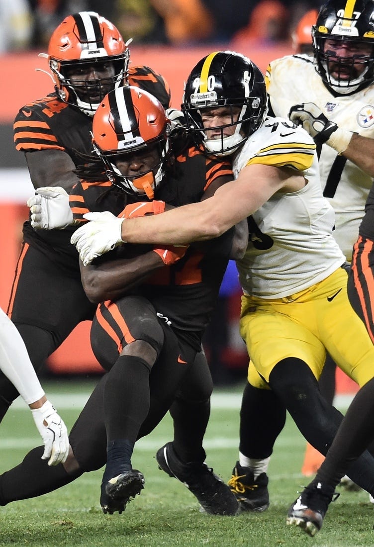 Nov 14, 2019; Cleveland, OH, USA; Pittsburgh Steelers outside linebacker T.J. Watt (90) tackles Cleveland Browns running back Kareem Hunt (27) during the second half at FirstEnergy Stadium.