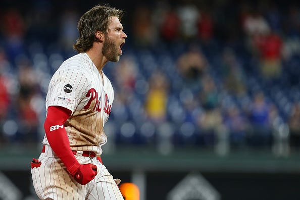 Bryce Harper celebrates a home run with the Phillies.