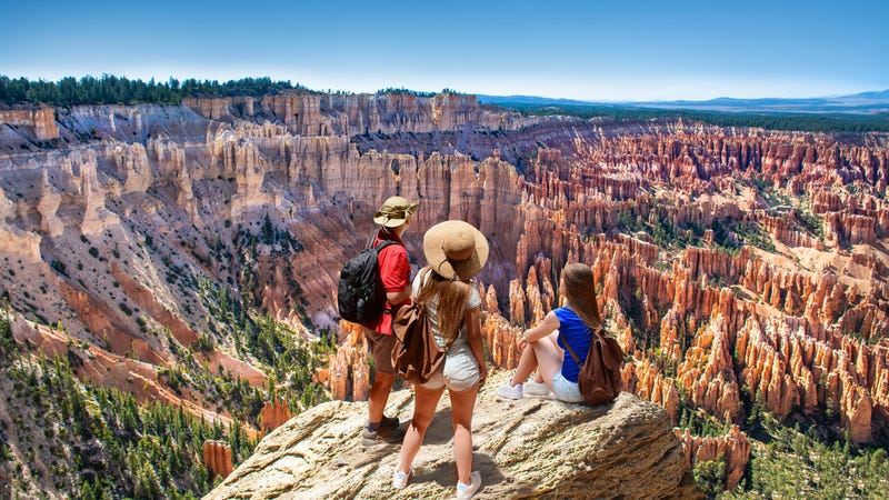 Family looking at the beautiful view of Inspiration Point, Bryce Canyon National Park, Utah, USA