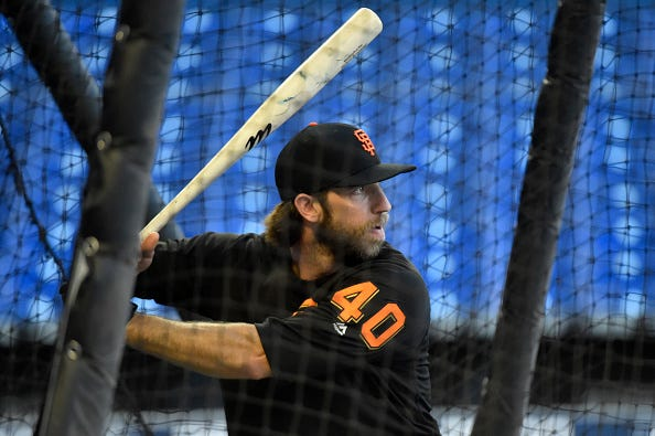 Madison Bumgarner takes batting practice with the Giants.
