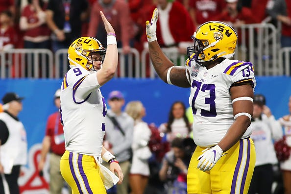 LSU QB Joe Burrow high-fives teammate Adrian Magee in the Peach Bowl.