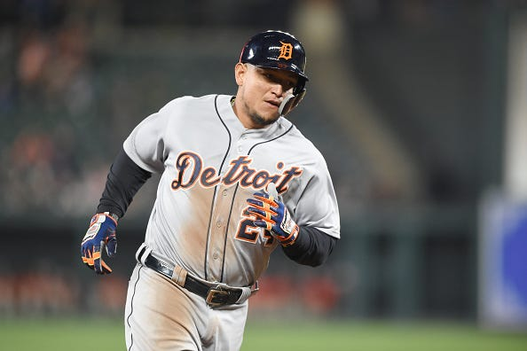 Miguel Cabrera trots around the bases after slamming a home run.