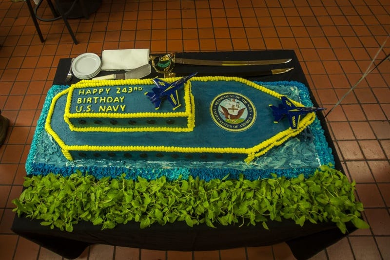 A birthday cake is displayed during the U.S. Navy's 243rd birthday at Anderson Hall, Marine Corps Base Hawaii (MCBH), Oct. 12, 2018.