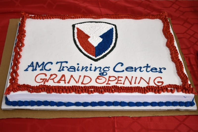 The photo displays a cake, designed for the Army Material Command (AMC) Training Center grand opening at Rose Barracks, Vilseck, Germany, Sept. 5, 2019.