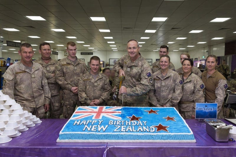 Lt. Col. Darren Beck, New Zealand Army, cuts the Waitangi Day cake in the dining facility at Camp Taji, Iraq, Feb. 6, 2019.