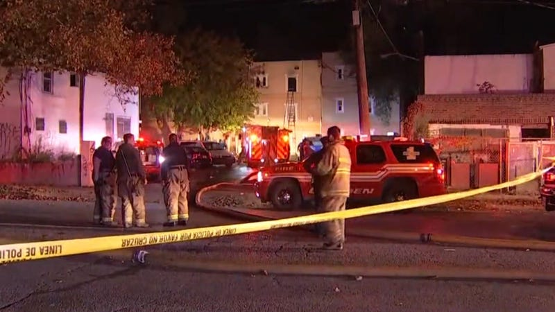 At least two people were killed and more than a half-dozen injured, including one firefighter, following a three-alarm fire at a Camden apartment building.