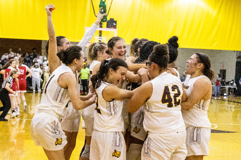 The Rowan University women's basketball team celebrates it's New Jersey Athletic Conference title.