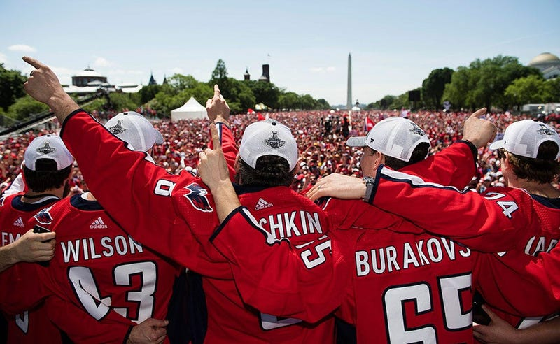 The Capitals embrace in front of 500,000 fans on the National Mall.