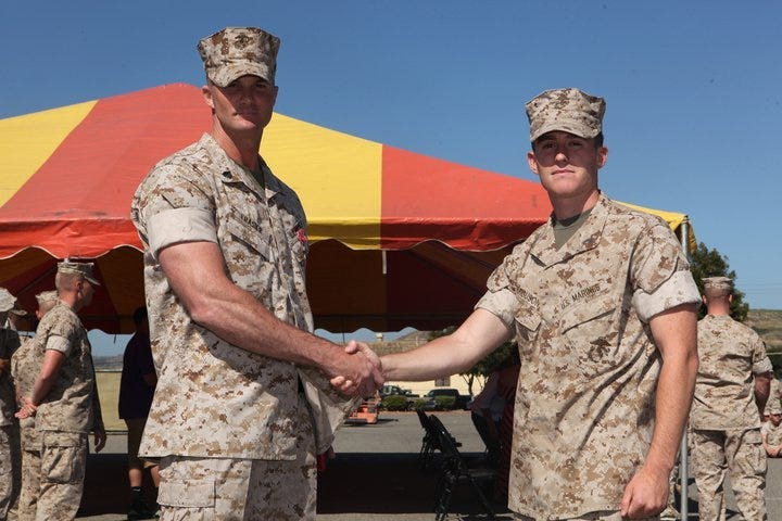 Captain James Ferguson presents Sgt. Josh Frasier with the Bronze Star Medal with Combat V at Camp Pendleton