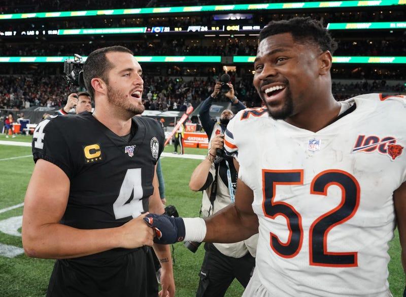 Derek Carr greets former Raiders teammate Khalil Mack.