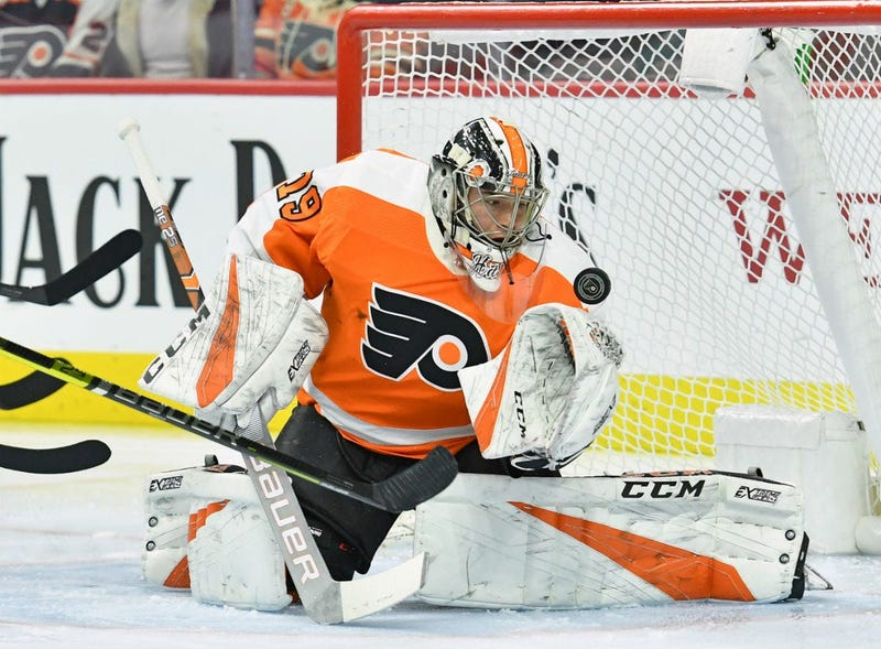 Philadelphia Flyers goaltender Carter Hart (79) makes a save against the Vancouver Canucks during the first period at Wells Fargo Center.