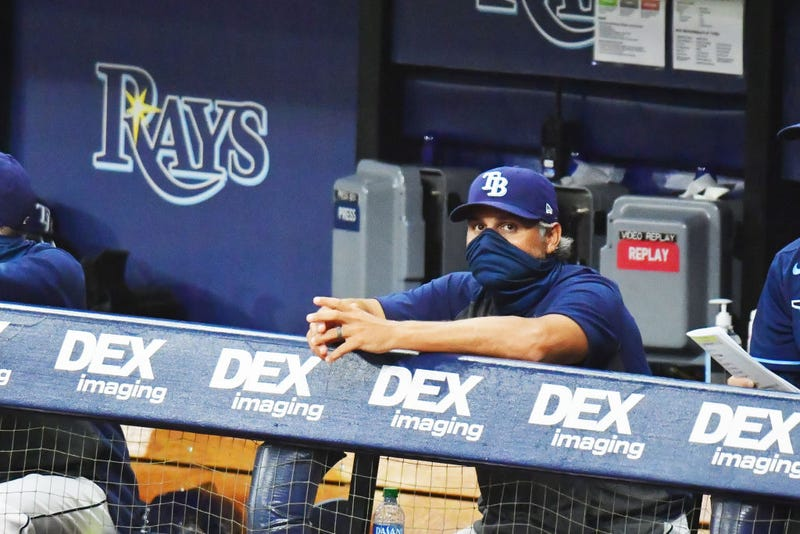 Kevin Cash looks on from the Rays dugout.