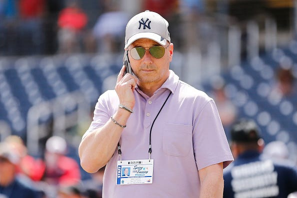Brian Cashman takes a call during Yankees spring training.