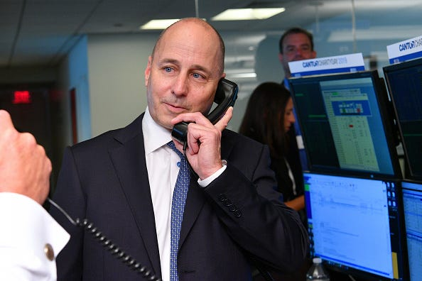 Yankees GM Brian Cashman visits Cantor Fitzgerald at its 9/11 charity day.