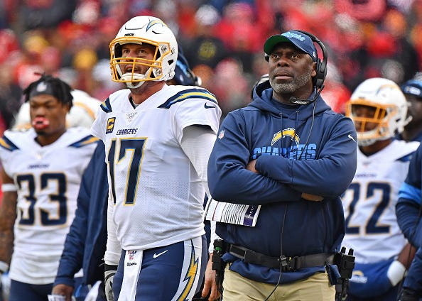 Philip Rivers and Anthony Lynn watch from the Chargers' sidelines.