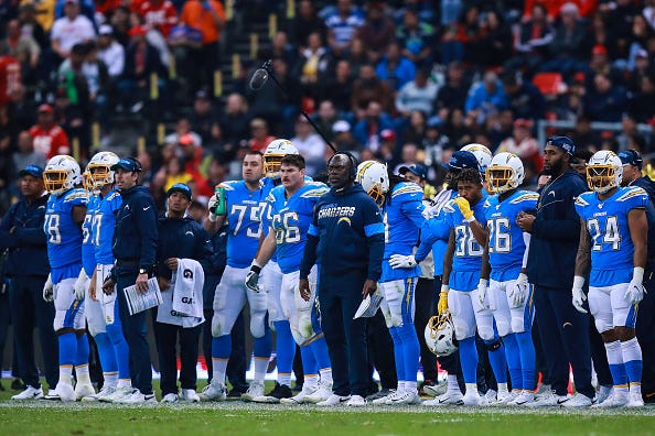 Anthony Lynn stands alongside his team on the Chargers sideline.