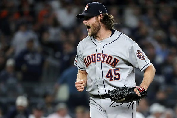 Gerrit Cole celebrates getting a big out against the Yankees.