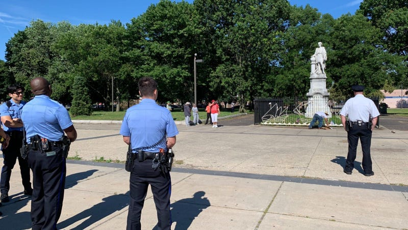 Philadelphia police stand guard in Marconi Plaza Sunday morning following reports of armed vigilantes around the Christopher Columbus statue.