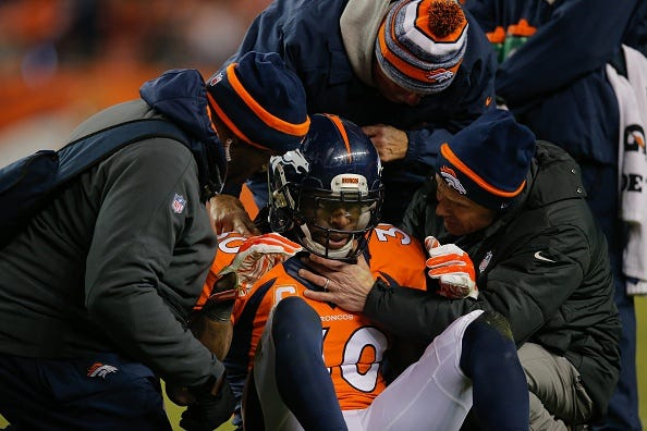 Broncos safety David Bruton is evaluated for a concussion.
